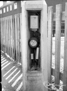 Dagenham street lighting, showing timer workings in pillar, next to fence in Crescent Road [north side of south limb, at Frizlands Lane corner], 1965