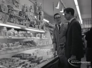 Health education, showing Inspector with Manager by refrigerated food shelves at Wallis Supermarket, Rush Green, 1965
