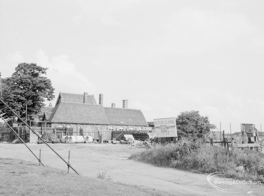 South side of Becontree Heath cleared for new development, looking east and with farmhouse with Victor D King sign, 1966