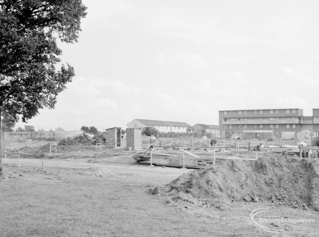 South side of Becontree Heath cleared for new development, with north block of Althorne Way flats under construction, 1966