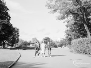 Valentines Park, Ilford, showing group of three people on path, 1966