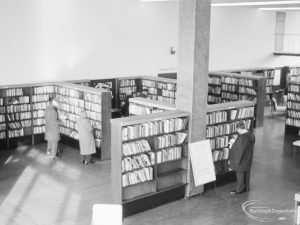 London Borough of Havering Central Library, Romford, showing part of the lending department [area to right of EES11822], with bookcases and library users, 1967