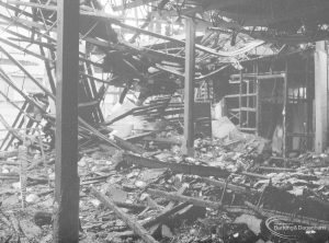 Fire at Barking Central Library, showing the lending department from south-west, looking over counter to east wall, 1967