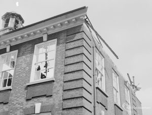 Fire at Barking Central Library, showing the south-east corner of old building on road, with broken windows, 1967