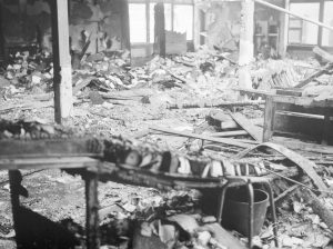 Fire at Barking Central Library, showing wrecked and burnt issue tray desks, 1967