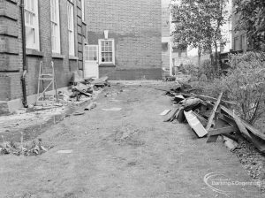 Fire at Barking Central Library, showing debris on ground below wall of original library, 1967