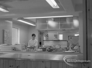 New Riverside Old People's Home for Senior Citizens, Thames View, showing view into kitchen with a member of staff, 1968