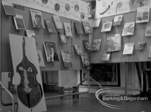 Barking Libraries Children's Book Week at Valence House, Dagenham, showing exhibition of children's books with cutout of cello and music display, 1969