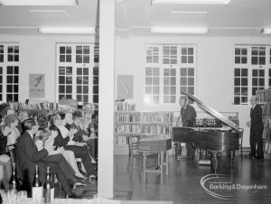 Rectory Library Music Circle twenty-first anniversary, showing members of audience and man standing next to piano, 1969