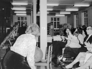 Rectory Library Music Circle twenty-first anniversary, showing woman bowing after her song performance and audience applauding, 1969