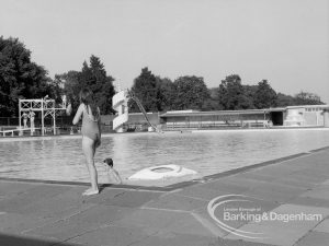 Two children playing in the water at the Barking Park open air Swimming Pool, 1969
