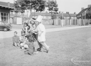 London Borough of Barking Libraries Department performance of play 'The Knave of Hearts' in grounds of Fanshawe Library, Dagenham and with Halbutt Street in background, produced by Mrs Jean Hickman, 1971