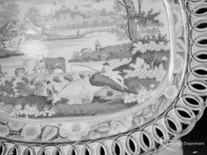 Victoria and Albert exhibition of English transfer-printed pottery and porcelain at Rectory Library, Dagenham, showing section of scene and decorative border on large dish, 1971