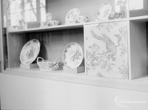 Victoria and Albert exhibition of English transfer-printed pottery and porcelain at Rectory Library, Dagenham, showing plates, cups and basket in cabinet, 1971