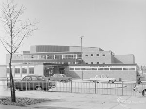 Dagenham Swimming Pool, Becontree Heath, showing entrance with four parked cars and tree (on left), 1972