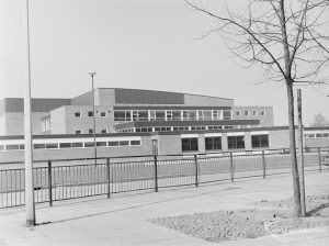Main structure of Dagenham Swimming Pool, Becontree Heath, omitting entrance, with bare tree on right, 1972