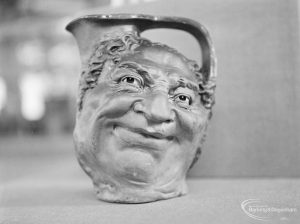 Victoria and Albert Exhibition on Martinware at Rectory Library, Dagenham, showing jug with grotesque human face, 1972