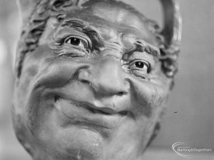 Victoria and Albert Exhibition on Martinware at Rectory Library, Dagenham, showing close-up of jug with grotesque human face, 1972