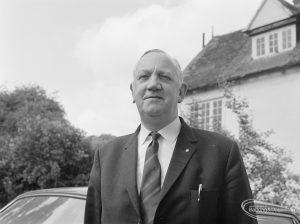 London Borough of Barking Borough Librarian Mr E W McManus FLA by his car, 1972