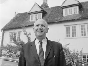 London Borough of Barking Borough Librarian Mr E W McManus FLA outside Valence House and smiling, 1972