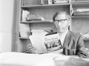 London Borough of Barking Deputy Borough Librarian Mr L Cannon FLA holding copy of 'The Barking Record', 1972