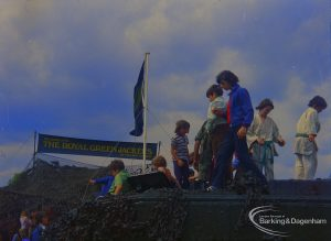 Dagenham Town Show 1973 at Central Park, Dagenham, showing Army display with boys on top of and inside Royal Green Jackets camouflaged tank, 1973
