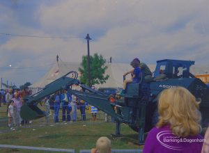 Dagenham Town Show 1973 at Central Park, Dagenham, showing Army display with spectators and boy being shown operation of mechanical digger, 1973