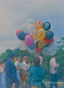 Dagenham Town Show 1973 at Central Park, Dagenham, showing balloon seller by Civic Centre with visitors walking by, 1973