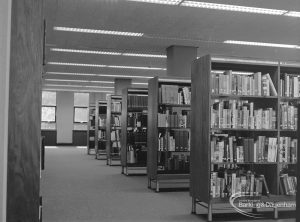 New Barking Central Library, Axe Street, Barking, showing six book stacks in Reference section, 1974