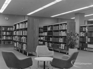 New Barking Central Library, Axe Street, Barking, showing bookcases, table and armchairs in Reference section, 1974
