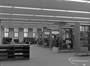 New Barking Central Library, Axe Street, Barking, showing bookcases and cabinet in Reference section, 1974