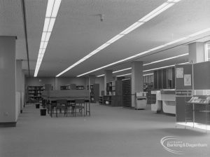 New Barking Central Library, Axe Street, Barking, showing general view of counter area, chairs and study desks in Reference section, 1974