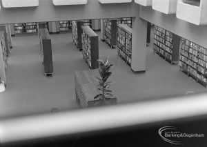 New Barking Central Library, Axe Street, Barking, showing view from first floor into Lending section to north, 1974