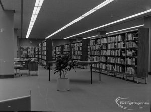 New Barking Central Library, Axe Street, Barking, showing Lending section, central area of bookcases taken from south, 1974