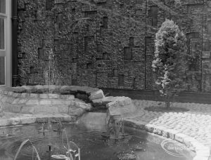 New Barking Central Library, Axe Street, Barking, showing cypress bush and pool in Water Garden feature, 1974
