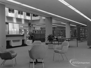 New Barking Central Library, Axe Street, Barking, showing armchairs, bookcases and counter in Lending section, 1974
