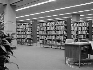 New Barking Central Library, Axe Street, Barking, showing bookcases and Librarian's desk in Lending section, 1974