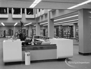 New Barking Central Library, Axe Street, Barking, showing Lending section with staffed counter, 1974