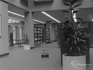 New Barking Central Library, Axe Street, Barking, showing plants by public catalogue cabinet in Lending section, looking north-west to bookcases, 1974