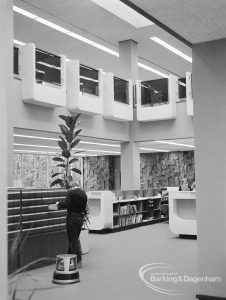 New Barking Central Library, Axe Street, Barking, showing Lending section with catalogue, counter, and view to first floor and ceiling, 1974