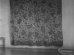 Detail of embroidered seventeenth century curtain on loan from Victoria and Albert Museum to Valence House, Becontree Avenue, Dagenham, removed for photograph from room opposite Period Room, 1975