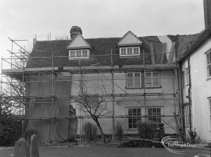 Valence House, Becontree Avenue, Dagenham in need of repair and renovation, showing general view of east wall, south wing, with roof, tarpaulin and scaffolding, 1977
