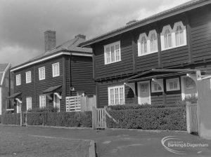 Timber housing in Wood Lane, Dagenham, showing 251 Wood Lane, looking north along green, 1977