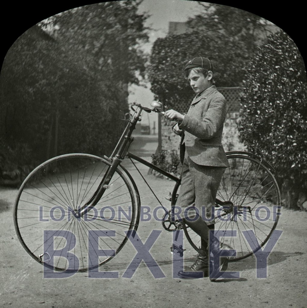 Boy with bicycle c1900