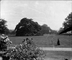 DEW125 Couple in a Garden, Probably Foots Cray Place. c.1900