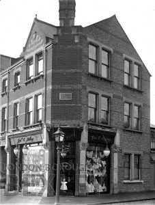 DEW168 Shop front of George E. Irving Outfitter, High Street Sidcup c.1900