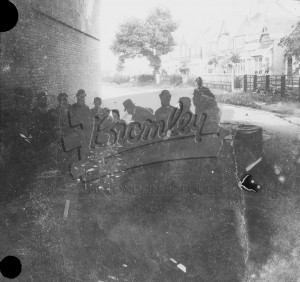 Group under railway arch,  1900s