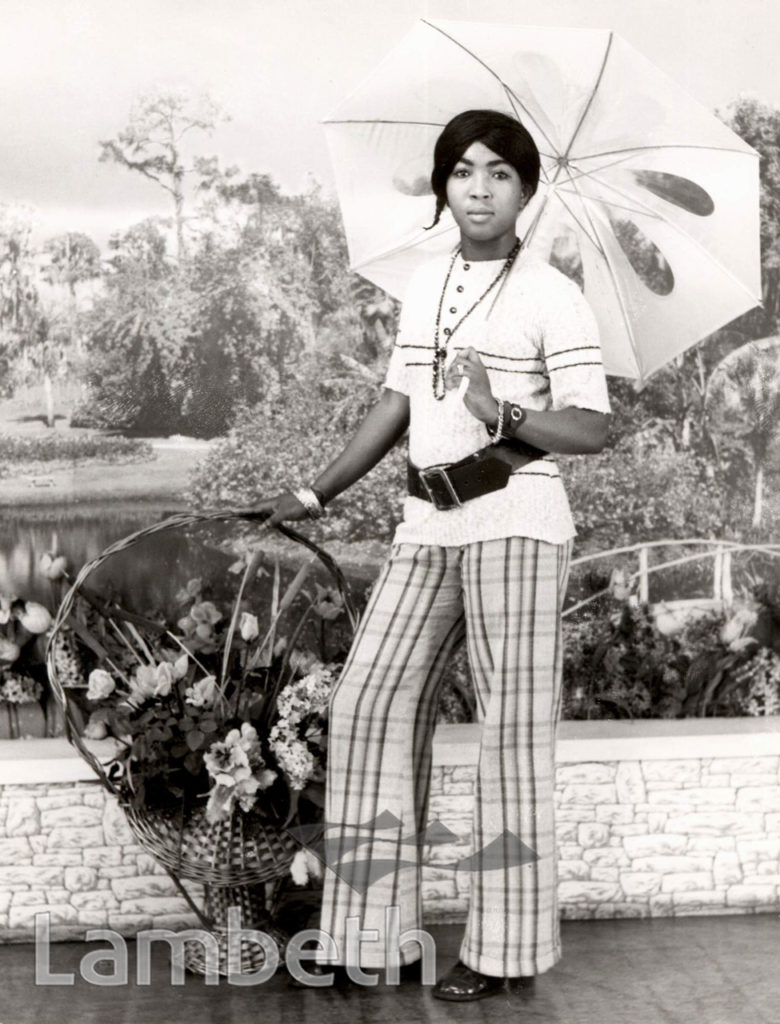 PORTRAITURE: YOUNG WOMAN WITH PARASOL