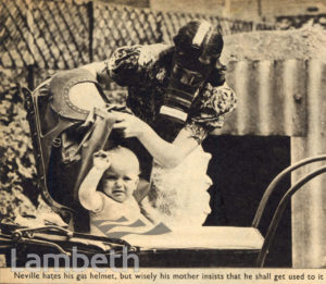 MOTHER & BABY WITH GAS MASKS: WORLD WAR II
