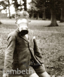 LAMBETH SCHOOLBOY WITH GAS MASK: WORLD WAR II